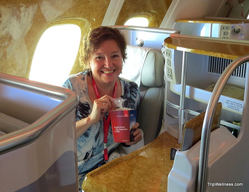 Elaine onboard, Living in the Age of Airplanes, Emirates, trip wellness