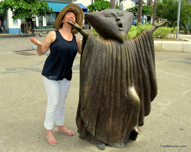 Elaine fools around on the Malecon. Boutique hotels in Puerto Vallarta. tripwellness