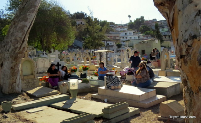 Family gathers inside the Puerta Blanca Cemetery, Tijuana
