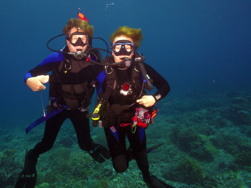 Two divers, Dave Rudie, Elaine Masters in the waters of Tubbatha Reef
