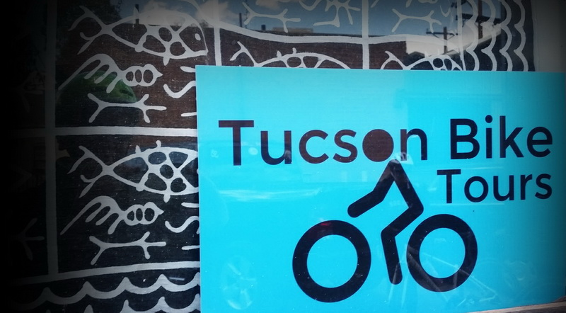 Tucson bike tour sign on the office door