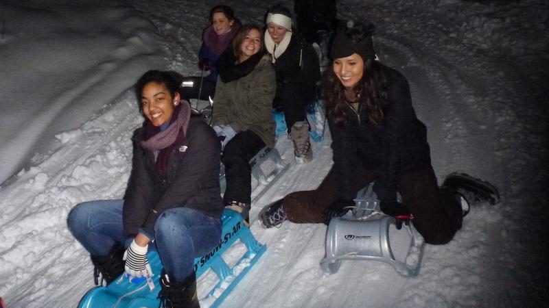 night sledding interlaken blue sled