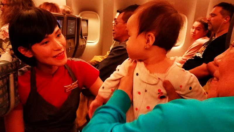 My seatmate charms the stewardess.