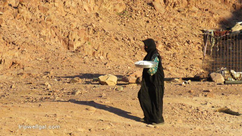 Bedouin woman brings bread to her tent