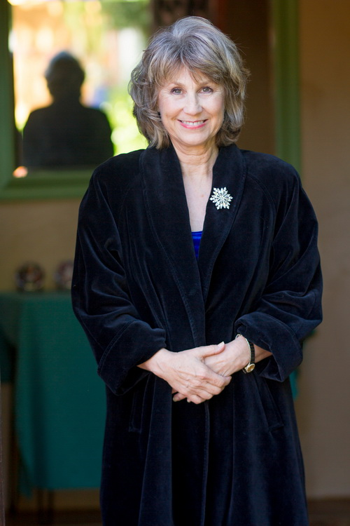 Jill G. Hall and the black coat that inspired her book series.