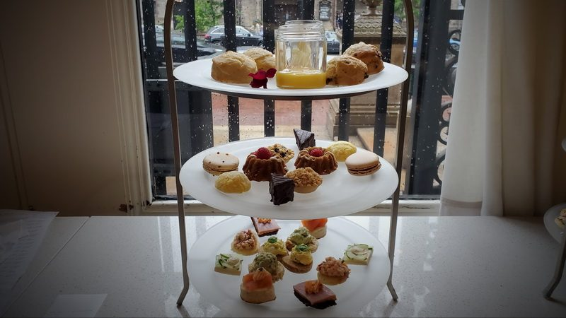 High tea sandwiches and sweets on the three tier tray.