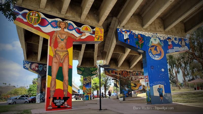Mural artist work in Chicano Park, San Diego