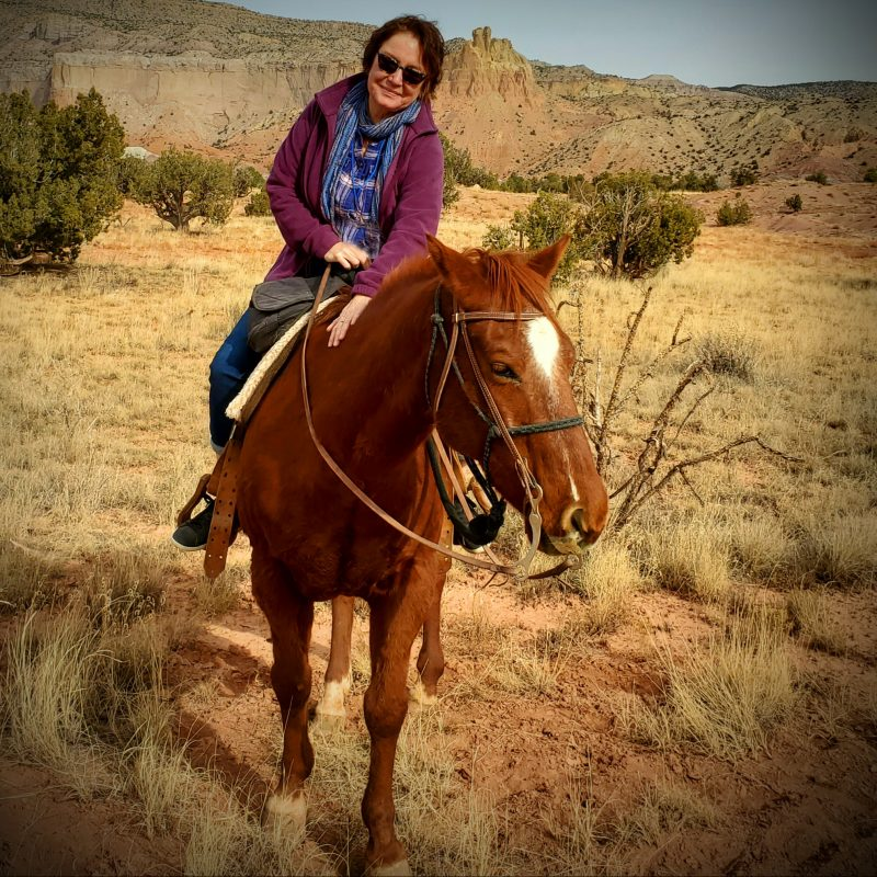 Elaine riding at Ghost Ranch, New Mexico