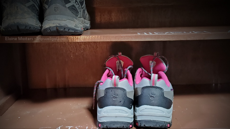 Pink detailed boots on a shelf in our Ryokan on the Kumano Kodo