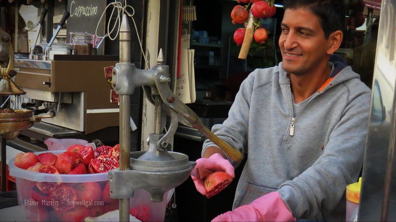 Street vendor juicing Pomegranates in Jordan