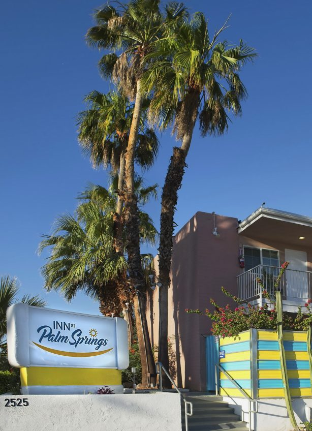 Palm trees and sign for the Inn at the Palm Springs